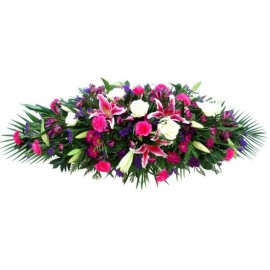cerise and purple double ended casket spray